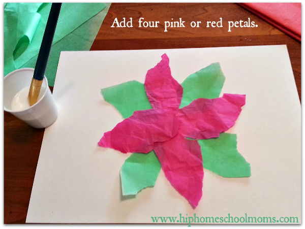 Add four pink or red tissue paper petals next. Don't glue them just yet. | Hip Homeschool Moms